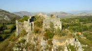 Stock Video Footage of Tourists on the walls of the ancient fortress areial RG