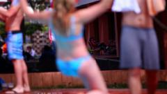 Boy push the girl in the pool at the hotel party slowmotion Stock Footage