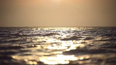 Beautiful sea wave and sky at sunset. Changes focus from foreground to Stock Footage