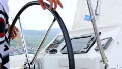 Sailor turns a metal steering wheel and operated with a boat RG Stock Footage