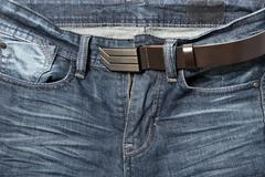 jean pant with leather belt - stock photo