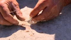 Man connecting wires on a dynamite in the rock Stock Footage