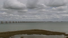 Zeeland Bridge, crossing the Eastern Scheldt (Oosterschelde) + pan tidal estuary Stock Footage