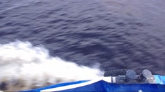 Waves from the ship cleave the water top view - stock footage
