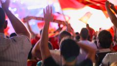 Fans celebrating the victory of their national team at the stadium Stock Footage