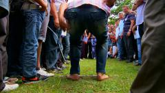 Men compete in the long jump on the village games - stock footage