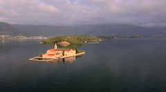 Aerial view of Island Gospa od Skrpjela on the sea in Montenegro Stock Footage