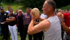 Men compete in throwing a stone from the shoulder Stock Footage