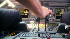 Pilot push thrust lever handle for takeoff a plane in the cockpit slowmotion RG Stock Footage