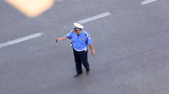 Policeman check a driver on the street Stock Footage