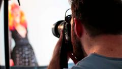 Professional photographer photographing a female models in the studio RG Stock Footage