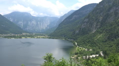 Lake and mountain view pan Austria alp meadow Stock Footage