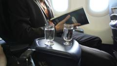 Passengers in the plane drink water from a glass RG Stock Footage