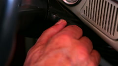 Man turns the key in the ignition lock of the old retro car close up rr - stock footage