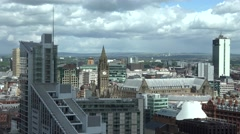 ULTRA HD 4K Timelapse cloud pass Manchester rooftop building crowded town church - stock footage