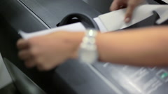Stewardess put tape on a suitcase at the airport conveyor belt RG Stock Footage