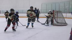 Teen Boys Playng Ice Hockey Game - 06 - Slow Motion Stock Footage
