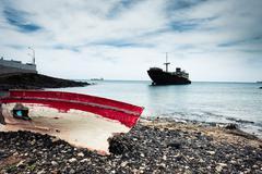 boat and broken ship on Lanzarote - stock photo