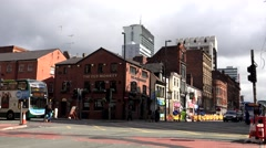 ULTRA HD 4K Timelapse busy road car pass bustling avenue Manchester town people  Stock Footage