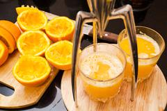 Squeezed orange juice from the glass Stock Photos