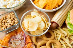 Stock Photo of close up of fast food snacks and drink on table