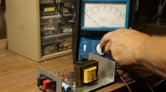 Engineer testing electronics with volt meter Stock Footage