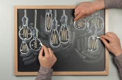 Lightbulb Chalkboard - stock photo
