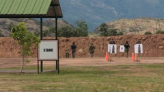 Trainees Run to Targets to Check Shooting Results Stock Footage