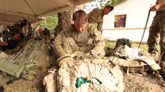 Stock Video Footage of US Soldiers Search in their Packs for MRE's (Meals Ready to Eat)