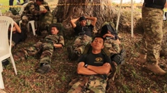 Columbian Paratroopers Rest during Break from Hard Training Stock Footage