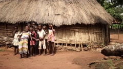 Stock Video Footage of African children in front of village house and laughing Guinea Bisseau