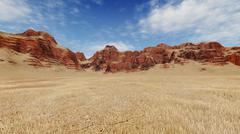 Stock Photo of Red rocks among barren lands