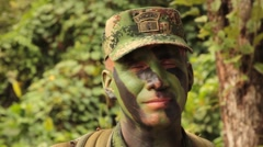 Columbian Paratrooper with Camouflage Face Paint - stock footage