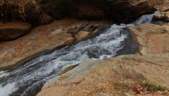 Shallow Waterfall Down Rockface Cliff Tropical Natural Hand held Slow-motion Stock Footage