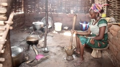 African woman smashing pepper with pistle, mortar in kitchen Guinea Bisseau Stock Footage