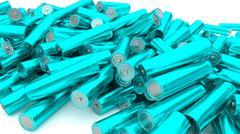 Stock of fallen cyan batteries 2 against white background - stock illustration