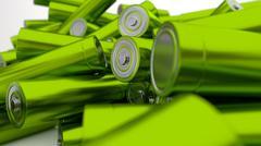 Stock of fallen green-yellow batteries 2c against white background - stock illustration