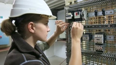 Young woman in professional training setting up electrical circuit - stock footage