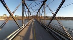 Crossing an old steel bridge Stock Footage