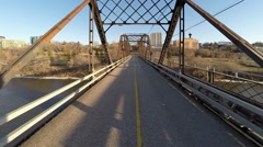 Crossing an old steel bridge - stock footage