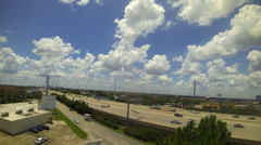 Freeway traffic and white billowing clouds time lapse Stock Footage