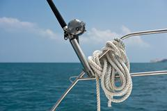 Fishing rod and reel on a yacht - stock photo