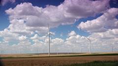 ULTRA HD 4K real time shot,The Wind turbines,wheat field,poppy flowers Stock Footage