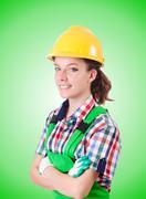 Woman builder against the gradient Stock Photos
