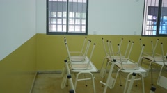 Chairs on the table at a school Stock Footage