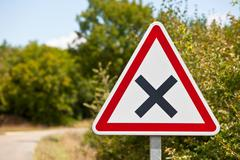 Crossroads road sign on a country road - stock photo
