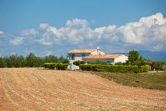 Farmhouse in a harvested lavender field Stock Photos