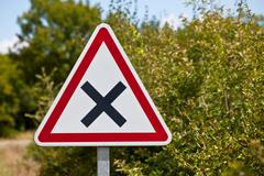 Stock Photo of Crossroads road sign on a country road