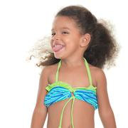 Cute small hispanic girl wearing a swimsuit Stock Photos