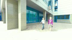 Children briskly walk around town and talk. - stock footage